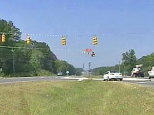 "The Department of Transportation installed a half light at an Apex intersection to control traffic, but residents call the measure ""a half baked idea."" The DOT installed the half light to relieve congestion at the intersection of U.S. Highway 64 and Kelly Road."