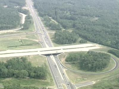 The new highway has been open only about a month,    but that is plenty of incentive for developers who have been waiting for road access to begin their projects.