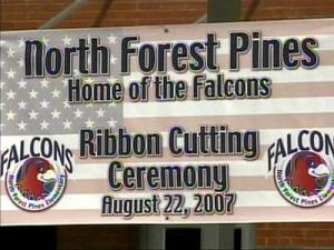 A crowd gathered at a ribbon-cutting ceremony for two elementary schools that marked an end to more than two years of controversy over the site of the schools.