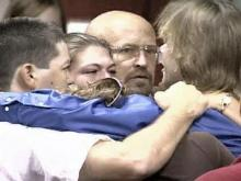 Family and friends surround Dwayne Allen Dail, 39, after he was declared innocent of child rape charges and freed by a judge on Tuesday, August 28.