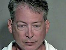 John McCormick mugshot, Chapel Hill lawyer charged with embezzlement