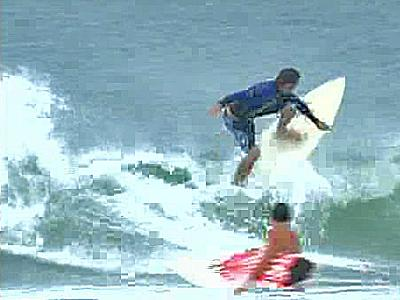 The gusty winds and heavy rains of Tropical Storm Gabrielle didn't prevent vacationers from grabbing some fun on the beach and in the ocean.