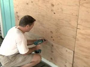 Beach homeowners often board up windows before a storm.
