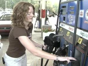 A woman fills her gas tank at the Triangle's only alternative fuel gas station.