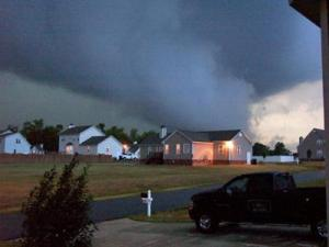 A funnel cloud takes shape as storms move through the area around Old Stage Road and N.C. Highway 42 in Wake County on Friday, Sept. 14, 2007. (Andrea Distler photo)