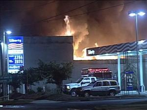 A fire at a Fayetteville strip mall forced authorities to close part of a nearby road and a gas station while firefighters worked to extinguish the blase early Monday.