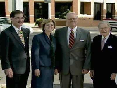Campbell School of Law Dean Melissa A. Essary and university President Jerry M. Wallace pose for a photo in front of the Hillsborough Place building on Oct. 3, 2007.