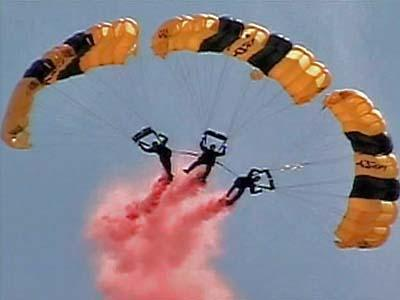 The Army's Golden Knights parachute teams drops in for the final air show at Pope Air Force Base on Thursday, Oct. 4, 2007.