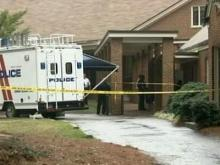 Police investigators examine the crime scene outside Lakeside Baptist Church in Rocky Mount, where two women were stabbed Thursday morning.