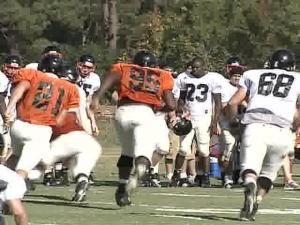"About 1,500 fans watched Saturday as the ""Fighting Camels"" hit the field."