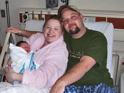 John and Rexana Neyland with their first-born son in 2005. John Neyland died in a wreck on Nov. 1, 2007, a day after his wife gave birth to their second son.