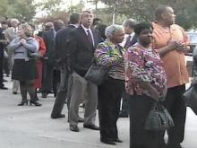 People lined the street to attend the wake for John Baker.