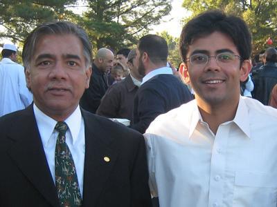 Tariq Hussain. left, with his son, Khurram Tariq, at Tariq's college graduation.