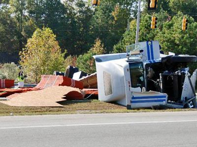 U.S. Highway 70 was closed Tuesday afternoon after a tractor-trailer carrying plywood overturned in Wilson's Mills. (Photo courtesy of John Payne)