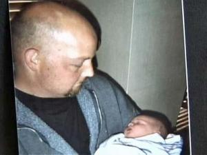 John Neyland holds his newborn son Hudson on Oct. 31. A day later, he died in a car accident going home from the hospital.