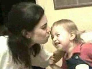 In this image taken from family home video, Michelle Young kisses her young daughter, Cassidy. Young was found dead in her home Nov. 3, 2006. Cassidy was by her side, unharmed.