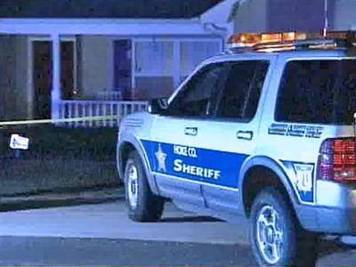 A Hoke County sheriff's car is parked outside a Raeford home where authorities say a 10-year-old boy accidentally shot his 9-year-old friend on Thursday, Nov. 15, 2007.