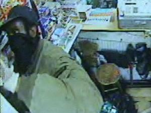 Surevillance video captures a glimpse of a man police believe is responsible for several break-ins at Durham's Town & Deli Grocery, and possibly other break-ins at another convenience store.