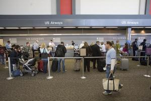 Passengers check in for their flights at RDU airport.