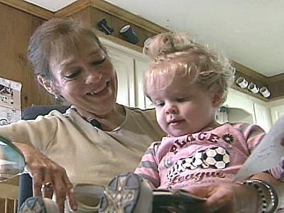 Donna Ferguson holds her 18-month-old granddaughter.