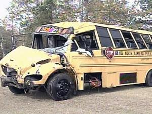 A 10-year-old child died Monday after the sport utility vehicle he was riding in struck a school bus in Lenoir County.