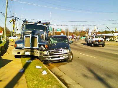 A dump truck and a pickup collided on Capital Boulevard, knocking down power lines and closing the thoroughfare to traffic.