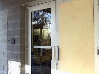 A piece of plywood covers part of the door of the Wake County Animal Care, Control & Adoption Center, where four pit pulls were stolen Dec. 2.