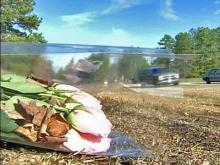 Pink roses lie alongside N.C. Highway 15 where a high-speed police chase ended in a head-on collision. Linsay Lunsford, 18, and her 9-year-old sister Maggie were killed when Guy Christopher Ayscue, 38, hit them while fleeing from police.