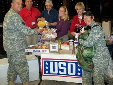 "Southwest Airlines and the USO made ""Operation Christmas Miracle"" possible and flew 180 Texas soldiers, temporarily stationed at Fort Bragg, home for Christmas, free of charge. (Photo by John Lucy)"