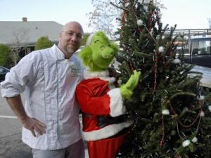 Warren Lewis, owner of Chef Warren's, stands next to a 5-foot-tall Grinch. It was stolen from outside his Southern Pines restaurant, but returned after video of the theft was posted on YouTube. (Photo courtesy by photographer Glenn Sides with The Pilot)