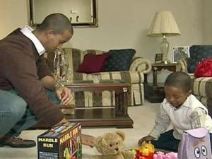 Cameron Brown plays with his father, Frank, on Christmas Day. Cameron's mother, Sheila, was deployed to southwest Asia.