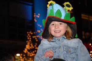 Seven-year-old Kimberly Hamilton shows off her festive flower hat.