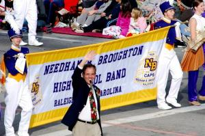 J.R. Richardson, director of the Broughton Marching Band, smiles and waves to the crowd of supporters at Tuesday's Rose Bowl Parade in Pasadena, Ca.
