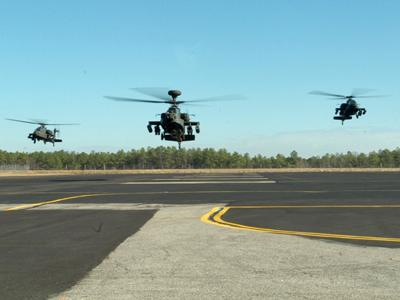 Three AH-64(D) Longbow helicopters from the 1st Attack Reconnaissance Battalion of the 130th Aviation Regiment, 449th Aviation Brigade, NC Army National Guard, prepare to land Sunday morning at the NC National Guard Flight Facility at RDU.