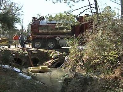 Environmental cleanup crews hired by Etheridge Oil Co. worked to remove gasoline from a creek in Kenly on Sunday, Jan. 6, 2008.