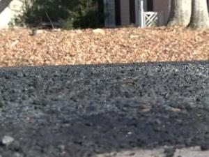 Residents of the Wood Valley subdivision in North Raleigh are concerned about a gravel and asphalt pavement treatment the state Department of Transportation used to repave its neighborhood roads.