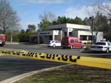 Police tape marks the scene of an attempted armored truck robbery outside the Bank of America in the Woodcroft area of Durham.