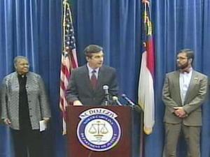 North Carolina Attorney General Roy Cooper (center) announced a joint effort with the Office of the Commissioner of Banks to plug local financial counselors into a national hotline for home foreclosure help (888-995-HOPE) on Feb. 4, 2008.