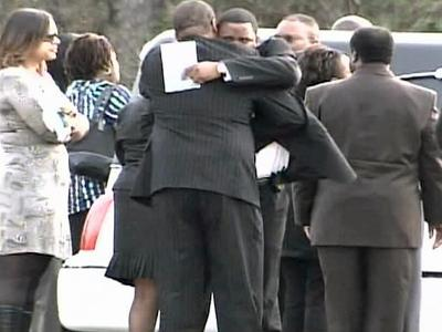 Dozens of mourners gathered Monday, Feb. 4, 2008, in Newport at God's City of Refuge for Latrese Matral Curtis' funeral.