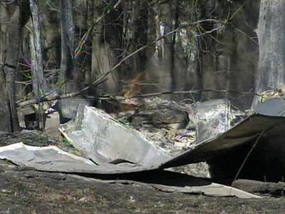 Firefighters battle a large woods fire near Matthews Road in Clayton.
