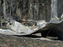 Firefighters battle a large woods fire near Matthews Road in Clayton on Sunday, Feb. 10, 2008.