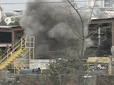 Ordnance experts from Fort Bragg detonate explosives Feb. 13, 2008, found at a Raleigh scrap metals processing plant.