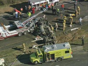 This photo from Sky 5 shows crews working the scene of an overturned traffic trailer.