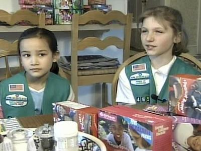 Erin Gillum and Charlene Penick were selling cookies to raise money for a trip to Colonial Williamsburg and Busch Gardens.