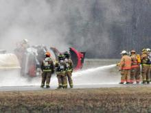 Firefighters hose down a tanker truck that overturned in Johnston County on Feb. 22, 2008. (Photo courtesy of John Payne)