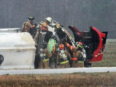 Firefighters work to free the driver from an overturned tanker in Johnston County on Feb. 22, 2008. (Photo courtesy of John Payne)