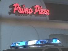 Police investigate an attempted robbery and stabbing at Primo's Pizza on Yadkin Road on Friday, Feb. 23, 2008.