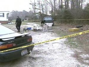 Sampson County deputies investigate a shootout at 1135 Old U.S. Highway 701, between Garland and Clinton, on Sunday, Feb. 24, 2008.