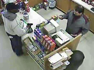 An armed man demands that a cashier give him money at the GNC store in Beaver Creek Commons in Apex.