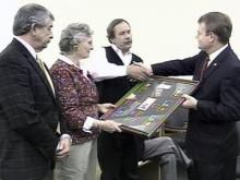 Congressman Mike McIntyre presents a collection of medals and honors of Sgt. George Byron Rose's family members on March 17, 2008. Rose was honored for his service and gallantry during World War II.